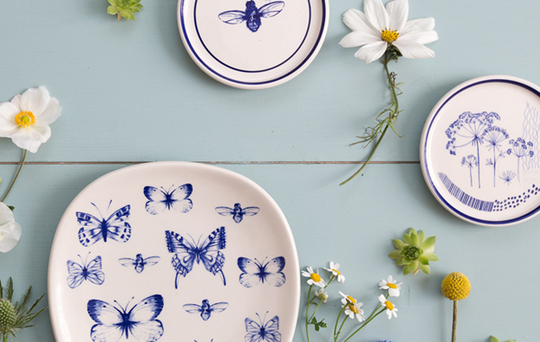 Kate Thorburn: What Kate Loves Butterfly Plate with other plates on a wall