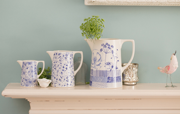 Set of three jugs on a shelf by Kate Thorburn
